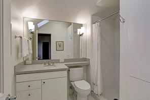 """Bedroom in Guest Quarters Over Garage with Living Room, Kitchen and Bath– 12' 4"""" x 16' 10"""": 9' ceiling height; Double casement window faces side ; Hardwood Floor; Closet # 1 – 6' 1 x 2' 6"""": storage closet with 3 adjustable shelves built into end wall; Closet # 2 – 6' 2"""" x 2' 3"""": single hanging bar and two sliding closet doors; Closet # 3 – 3' 1"""" x 2' 3"""": single hanging bar and sliding closet door"""