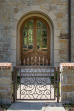 Entrance - Magnificent rococo-style mahogany doors surrounded by limestone cladding announce the front entrance.