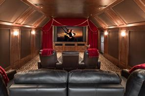 Game Room - Robert Dame had a vision with this Wimbledon inspired shape, ceiling woodwork and wood paneling. Alternate view of the game room reveals the tall glass doors that access a balcony overlooking the bayou.