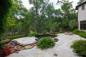 Patio, Pool and Firepit - Flagstone hardscape surrounds the grotto pool and waterfalls. Patios offer spectacular views of Buffalo Bayou.