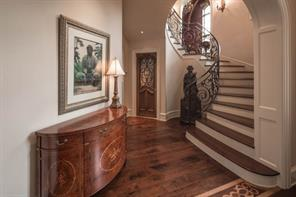 Front Elevation - Norman French architecture and light-filled. Highly custom interiors distinguish this exceptionally fine Robert Dame-designed home, custom-built for the sellers.