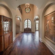 Dining Room -  The 20' x 14' dining room amenities include floor-to-ceiling windows; Venetian plaster walls by Segreto; paneled wainscot; walnut floor, wall recesses; and superb nine-light crystal chandelier.