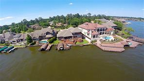 Overlooking a very broad inlet, the view across the water is due south.  Multi-tier decking leads down to your boat dock which means it's below eye level allowing for unobstructed open water views.