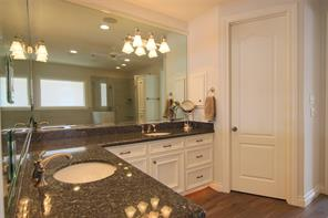 Like the bedroom, the master bath is quite large with high counters and double sinks.