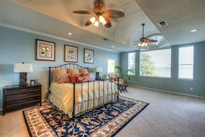Pictured is the Master bedroom located upstairs that is accented with a barrel ceiling and endless views of the lake.