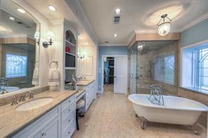 Luxurious upstairs master bath appointed with a soaking claw foot tub and steam shower!