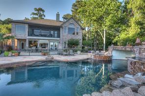 This backyard is a waterfront paradise with pool that offers grotto and hot tub plus a kiddie pool to boot!