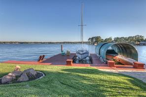 Boat dock offers two electric boat lifts, one covered and a jet ski lift.