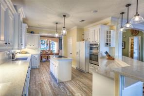 Kitchen has been updated with new stainless steel appliances, lighting and beautiful tile floors throughout.
