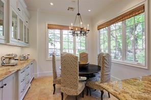 The elegant MASTER BATH includes a barrel vaulted ceiling, his/her marble vanities, marble flooring with decorative insets and an exceptionally large closet with built-in shelving and drawers.