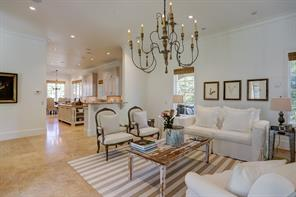The FAMILY ROOM (18 X 19) is exquisite with its stone flooring, painted walls, crown/base molding, mullioned windows with Roman shades.