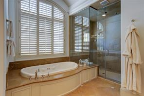 The Master Bath also includes a Bain Ultra tub with marble surround and a walk-in marble shower with glass door front.