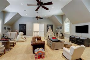 A great multi use space for a game room, quarters or Bedroom #5 ! - the room (23 X 23) includes carpeted flooring, ceiling fan, recessed lighting, en suite bath (granite counters, slate tile flooring, tub/shower, stone surround) and storage closet.