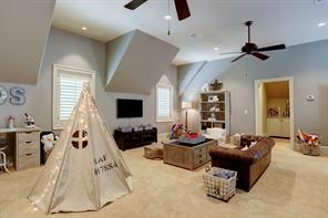 A very flexible space for a growing family as their needs change from play room to potential guest bedroom or media room!