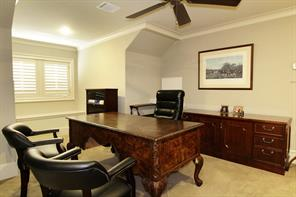 The third floor features an office-bedroom easily accessible by both the staircase and elevator and includes carpeted flooring, window seat, plantation shuttered windows, recessed lighting and en suite bath.