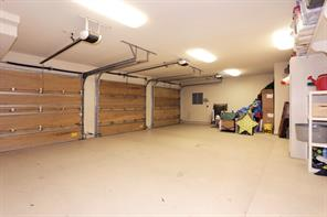A spacious three car GARAGE with a built-in workshop for the handyman of the family.