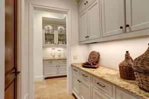 A great home for entertaining - notice the abundance of counter and storage space in the BUTLER'S PANTRY with its granite counter top and painted cabinets/drawers.