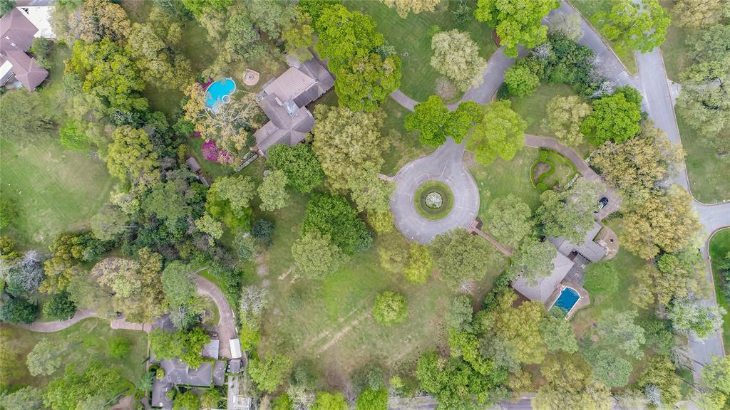Exceptional park-like, nearly 5-acre tract (3 contiguous homesites) suitable for a one-of-a-kind estate compound. 5345 Spring Park, and 5360 Spring Park also for sale.