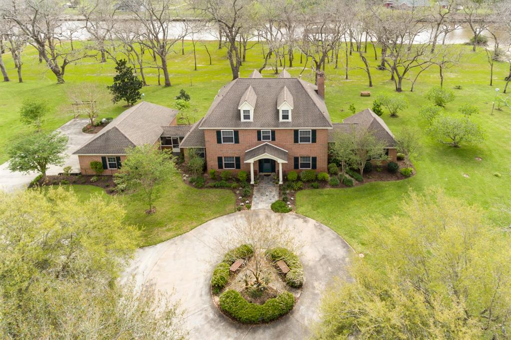 This luxury estate, with over 500 ft. on the San Bernard River, sits on over 6 acres. While the home is very well appointed and elegant, it is comfortable and practical. Located on the first floor are spacious living areas, formal dining, kitchen, breakfast area, butler's pantry, walk-in pantry, sunny laundry room and half bath. Additionally, there is a lovely guest suite that includes a full bath, bright sitting room and bedroom.(your guests won't want to leave) Fall in LOVE with the upstairs Master Bedroom that features a sitting room w/ fireplace. The two screened porches will afford a great place to meditate and listen to the birds or visit with family and friends. Hardwood, pecan and fruit trees add to the value and beauty of this property. BUYER MUST BE APPROVED...