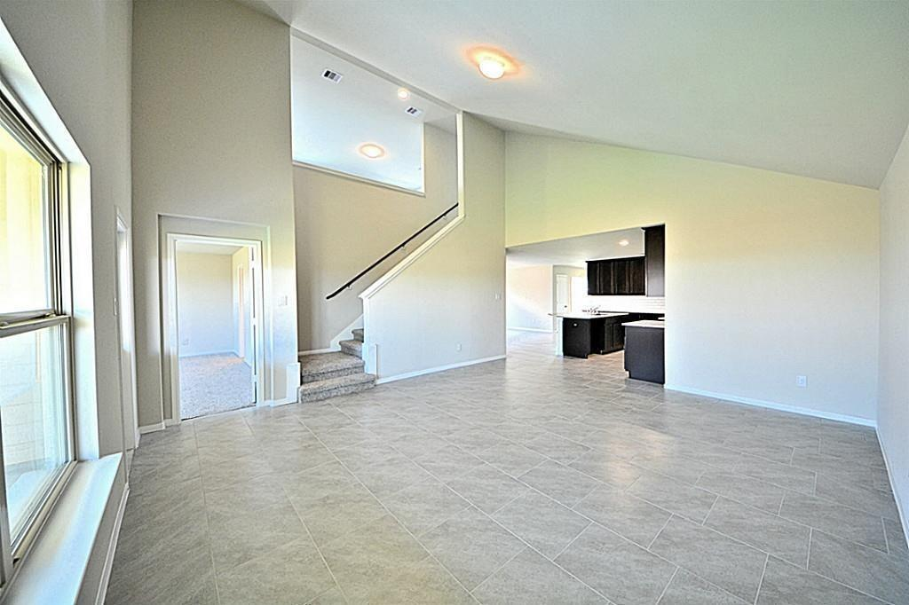 Grand Family Room Has Picture Frame Balcony Looking Down The Amazing With Upgraded Large Tile Floors That Leads Into Your Wonderful Gourmet