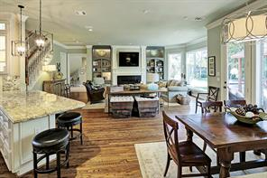 Notice the open floor plan and to the right is a banquette in the breakfast room.
