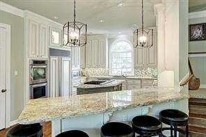 The 2012 kitchen remodel features a large breakfast bar with granite counters.