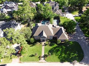 The stately home is 6306 sq.ft. with 6 bedrooms & 5 full baths and 2 half baths and is on a large 19,832 sq.ft. corner lot with a 3 car garage.  Notice the 2012 roof.