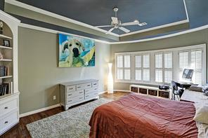 Huge secondary bedroom with hardwoods with plantation shutters