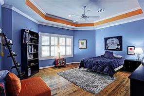 Another spacious secondary bedroom with hardwoods