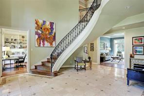 The grand foyer features marble floors, curved staircase with iron railings and recent hardwoods on the stairs.  In 2012, the interior of the home was painted.  In 2016, the exterior of the home was painted.