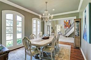 Spacious formal dining with 2012 windows and hardwoods
