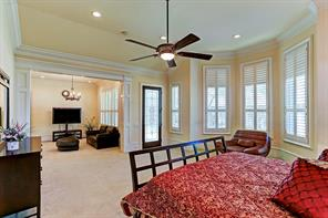 Spacious master suite on the first floor includes a large sitting room and bath