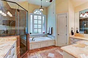 Master bath with separate shower and marble counters
