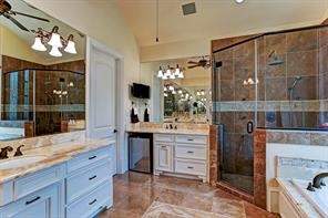 Another view of the master bath which opens into a  fabulous closet  at the back