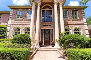 Leaded glass doors and side panels welcome you into this immaculate home