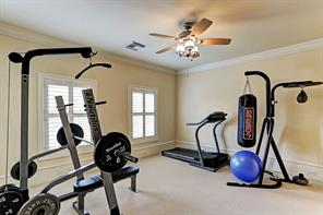 The fourth upstairs bedroom is set up a work out room