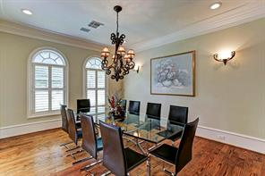 High ceilings throughout the home including the large dining room with hardwoods, chandelier and  windows with plantation shutters