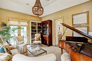 This downstairs room is off the family room with hardwood floors and french doors to grounds. Currently serving as a music room, this room could also make a great library with the built-in book cases.