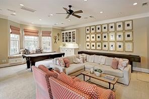A downstairs gameroom is hard to find and this one can accomodate a pool table, shuffle board, wet bar and entertainment center with plenty of seating!  There is also access to yard, pool, spa and outdoor kitchen.