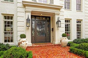 From the Herringbone brick entry with dramatic glass lanterns, ths house shines!