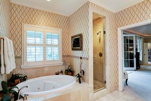 Upstairs master bath has marble floors and counters, whirlpool soaking tub, separate shower, dual sinks and separate vanity and dual closets.