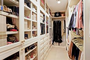 One of 2 master closets.  This was custom designed for shoes, handbags, hanging clothes and lots of drawer space.