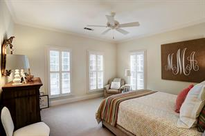 Welcome to 1 of 5 secondary upstairs bedrooms.  This bedroom is to the left of the formal staircase and faces north.  There are custom shutters to let in light.  There is also a private bath.