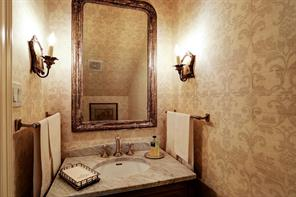 1 of 2 half bath downstairs.  This is the formal powder room with Schumacher wallpaper and marble since.  It is located to the right of the entry.
