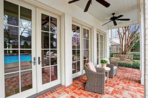 This charming covered loggia has ceiling fans and brick pavers and is great for enjoying your morning coffee or evening wine!