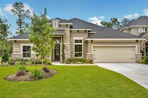 Situated in Conroe's newest Master Planned Community - Grand Central Park, this Jaeger Home custom 1.5 story is loaded with upgrades and provides 3,076 sq. ft.