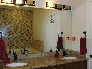 Master bathroom with granite  counter top & double sinks with brushed bronzed faucet