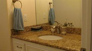 upstairs guest bathroom with granite counter top
