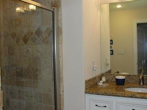 Upstairs bathroom with shower and granite counter top