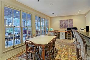 The huge breakfast room is open to the kitchen and has a wall of windows viewing the magnificent backyard. The family uses this space also for a homework area for the kids but it could also be a TV den. The breakfast bar is between the breakfast room and kitchen.